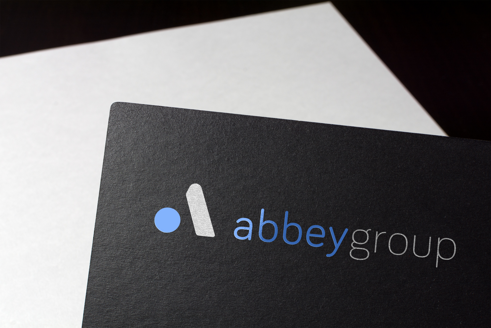abbey group logo on black card